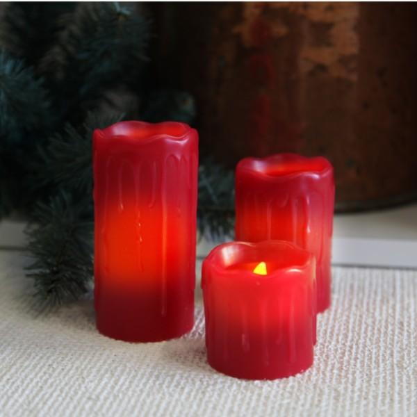 """LED Kerzenset """"Drip"""" - Echtwachs - Schwung-Oberkante - Wachstropfen - flackernde LED - 3er Set - rot"""