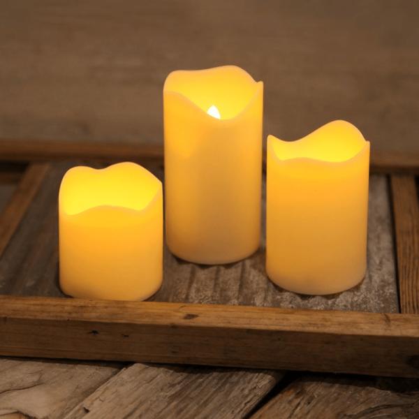 """LED Kerzenset """"Wave"""" - Kunststoff - flackernde LED - Timer - H: 4/6/7cm - creme - 3er Set"""